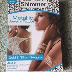 Jewelry - NWT never opened Metallic Jewelry Tattoos